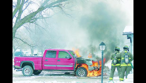 Albion Fire Department responded to a vehicle fire on Jan. 21 in Albion. The fire started in the engine compartment and was apparently caused by an electrical malfunction. Fire Chief Bruce Benne said the fire was extinguished in about 15 minutes. Photo by Thomas Hosford of the Albion News.