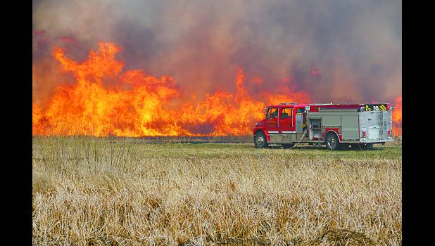 Gilbertville Fire conducted a controlled burn on Thursday, April 2, on Girsch Rd. at Gilbertville. Photos by Larry Klodt.