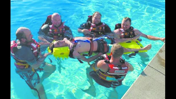 The Onida Fire Department did some water rescue training at the Onida swimming pool in July.  It was interesting and challenging trying to operate in the water while trying to package a patient safely for getting out of the water.